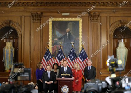 United States Representative Adam Schiff (Democrat of California), Chairman, US House Permanent Select Committee on Intelligence, speaks as (left-right), Speaker of the United States House of Representatives Nancy Pelosi (Democrat of California), United States Representative Jerrold Nadler (Democrat of New York), United States Representative Maxine Waters (Democrat of California), Representative Eliot Engel (Democrat of New York), United States Representative Carolyn Maloney (Democrat of New York), United States Representative Richard Neal (Democrat of Massachusetts), at a news conference laying out articles of impeachment for President Trump, on Capitol Hill.