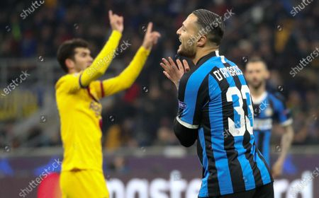 Inter's Danilo D'Ambrosio reacts during the UEFA Champions League group F soccer match between FC Inter and FC Barcelona at the Giuseppe Meazza stadium in Milan, Italy 10 December 2019.