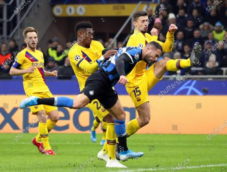 Inter's Danilo D'Ambrosio (C) in action during the UEFA Champions League group F soccer match between FC Inter and FC Barcelona at the Giuseppe Meazza stadium in Milan, Italy 10 December 2019.