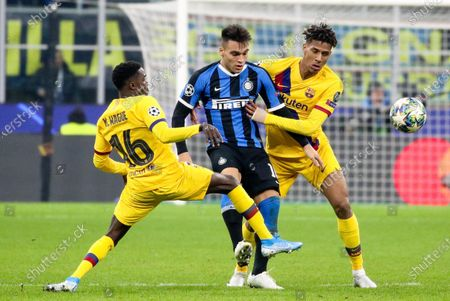 Stock Picture of Inter's Lautaro Martinez (C), Barcelona's Moussa Wague (L) and Jean-Clair Todibo in action during the UEFA Champions League group F soccer match between FC Inter and FC Barcelona at the Giuseppe Meazza stadium in Milan, Italy 10 December 2019.