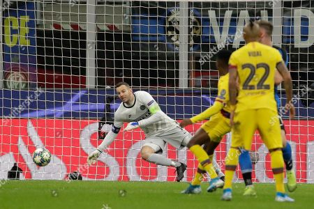 Inter Milan's goalkeeper Samir Handanovic, left, fails to save the ball as Barcelona's Ansu Fati, scores his side's second goal during the Champions League, group F soccer match between Inter Milan and F.C. Barcelona, at the San Siro stadium in Milan, Italy
