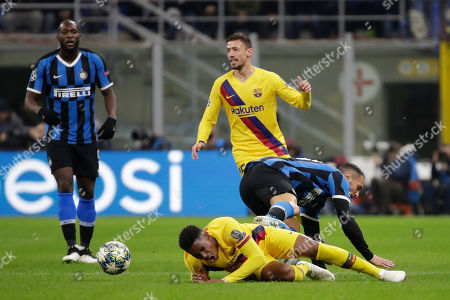 Stock Picture of Barcelona's Junior Firpo, bottom, is tackled by Inter Milan's Danilo D'Ambrosio during the Champions League, group F soccer match between Inter Milan and F.C. Barcelona, at the San Siro stadium in Milan, Italy