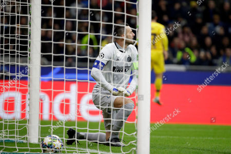 Inter Milan's goalkeeper Samir Handanovic, left, reacts after Barcelona's Carles Perez, scores his side's opening goal during the Champions League, group F soccer match between Inter Milan and F.C. Barcelona, at the San Siro stadium in Milan, Italy