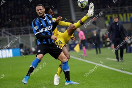 Stock Image of Barcelona's Junior Firpo, right, fights for the ball with Inter Milan's Danilo D'Ambrosio during the Champions League, group F soccer match between Inter Milan and F.C. Barcelona, at the San Siro stadium in Milan, Italy