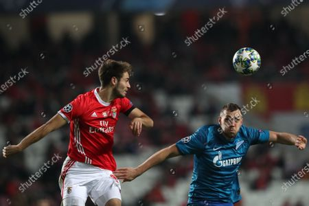 Benfica's Francisco Ferreira 'Ferro' (L) fights for the ball with Zenit's Artem Dzyuba during the UEFA Champions League Group G soccer match between Benfica and Zenit St Petersburg held at Luz Stadium, Lisbon, Portugal, 10 December 2019.