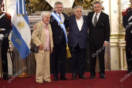 New Argentinian President Alberto Fernandez (C-L) and future Foreign Minister Felipe Sola (R) pose next to Uruguayan former President Jose Mujica (C-R) and current Vice-President Lucia Topolansky (L) in Buenos Aires, Argentina, 10 December 2019.