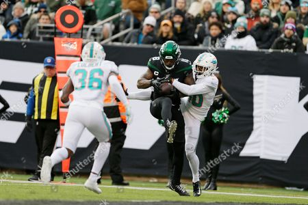 Stock Photo of New York Jets wide receiver Demaryius Thomas (18) scores a touchdown during the second quarter of an NFL football game against the Miami Dolphins, in East Rutherford, N.J