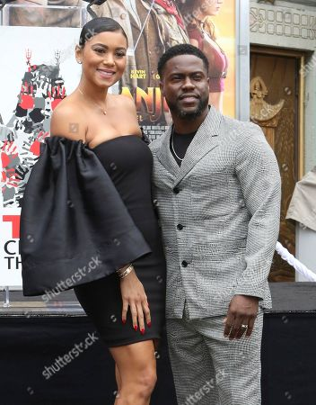 Kevin Hart, Eniko Parrish. Kevin Hart, right, and his wife Eniko Parrish pose during a hand and footprint ceremony honoring Hart at the TCL Chinese Theatre, in Los Angeles