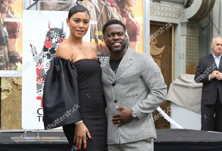 Stock Image of Kevin Hart, Eniko Parrish. Kevin Hart, right, and his wife Eniko Parrish pose during a hand and footprint ceremony honoring Hart at the TCL Chinese Theatre, in Los Angeles