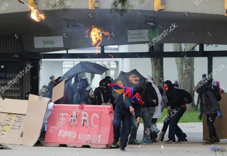 Anti-government students launch petrol bombs at the police during clashes in Bogota, Colombia, . The students are part of a protest that is demanding that President Ivan Duque not make changes in the tax, labor and pension laws that are either before the legislature or rumored to be in development