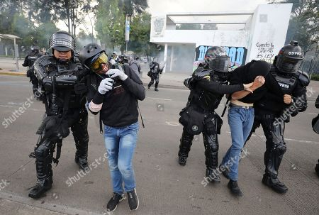 Riot police detain students during a national strike in Bogota, Colombia, . The student was part of a protest who's demands include asking President Ivan Duque to not make changes in the tax, labor and pension laws that are either before the legislature or rumored to be in development