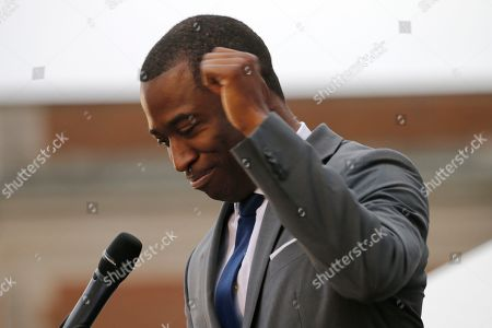 Richmond Mayor Levar Stoney, gestures as he delivers remarks during the unveiling ceremony for a statue titled Rumor's of War by artist Kehinde Wiley at the Virginia Museum of Dine Arts in Richmond, Va., . The monumental bronze sculpture of a young black man astride a galloping horse was unveiled Tuesday, set to be permanently installed in Virginia's capital city, not far from the Confederate monument it mimics