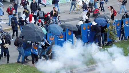 Demonstrators face the Anti-Riot Police (ESMAD) during a protest against the Government of President Ivan Duque at the National University in Bogota, Colombia, 10 December 2019.