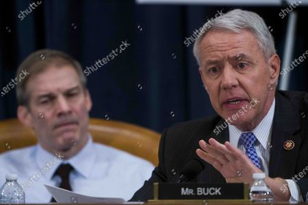 United States Representative Ken Buck (Republican of Colorado) questions during the US House impeachment inquiry hearings, with US Representative Jim Jordan (Republican of Ohio) looking on from left.