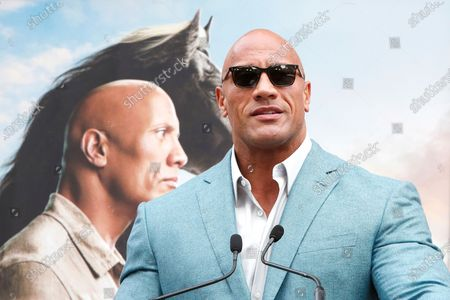 Dwayne Johnson speaks during a hand print ceremony for Kevin Hart at the TCL Chinese Theatre IMAX in Hollywood, Los Angeles, California, USA, 10 December 2019.