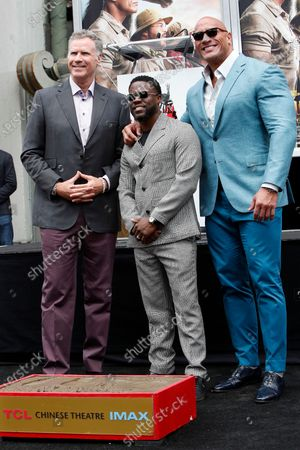 Will Ferrell, Kevin Hart, and Dwayne Johnson pose during a hand print ceremony for Kevin Hart at the TCL Chinese Theatre IMAX in Hollywood, Los Angeles, California, USA, 10 December 2019.