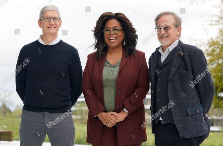 Apple CEO Tim Cook, from left, Oprah Winfrey and Steven Spielberg outside the Steve Jobs Theater during an event to announce new Apple products in Cupertino, Calif. Apple TV Plus launched Nov. 1 with Winfrey and Spielberg among its first wave of producers, and was quickly followed by Disney Plus
