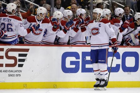 Montreal Canadiens' Shea Weber (6) returns to the bench after scoring during the second period of an NHL hockey game against the Pittsburgh Penguins in Pittsburgh