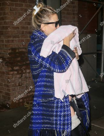 Stock Image of Kate Hudson holds baby Rani Rose Hudson Fujikawa