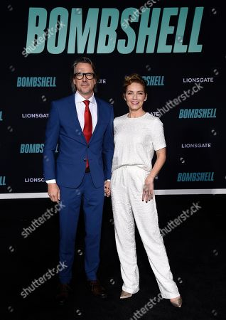 """Charles Randolph, Mili Avital. Charles Randolph and Mili Avital attend the premiere of """"Bombshell"""" at Regency Village Theatre, in Los Angeles"""
