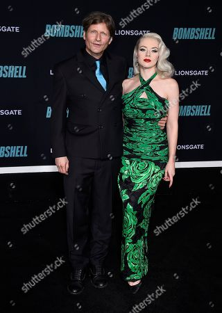 """Crispin Glover, Mosh. Crispin Glover and Mosh attend the premiere of """"Bombshell"""" at Regency Village Theatre, in Los Angeles"""