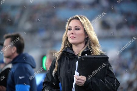 FOX Sports television sideline reporter Jennifer Hale watches from the field during the second half of an NFL football game between the Jacksonville Jaguars and the Los Angeles Chargers, in Jacksonville, Fla