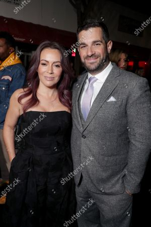 Alyssa Milano and Dave Bugliari attend the Los Angeles Special Screening of Lionsgate's BOMBSHELL at the Regency Village Theatre in Los Angeles, CA on December 10, 2019.