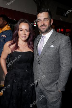 Stock Photo of Alyssa Milano and Dave Bugliari attend the Los Angeles Special Screening of Lionsgate's BOMBSHELL at the Regency Village Theatre in Los Angeles, CA on December 10, 2019.