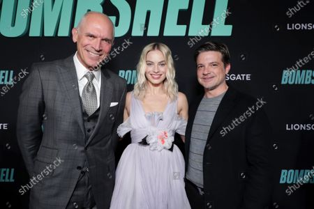 Joe Drake, Co-Chairman of Lionsgate Motion Picture Group, Margot Robbie and Damon Wolf, President of Worldwide Marketing, Lionsgate Motion Picture Group, attend the Los Angeles Special Screening of Lionsgate's BOMBSHELL at the Regency Village Theatre in Los Angeles, CA on December 10, 2019.
