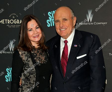 """Judith Giuliani, Rudy Giuliani. Judith Giuliani, left, and former New York mayor Rudy Giuliani, right, attend the premiere of """"Sing Street"""" at Metrograph, in New York. Giuliani and his third wife, Judith, have reached a settlement in a yearslong court battle that exposed details about their luxurious lifestyle, The New York Times reported on Tuesday, Dec. 10, 2019"""