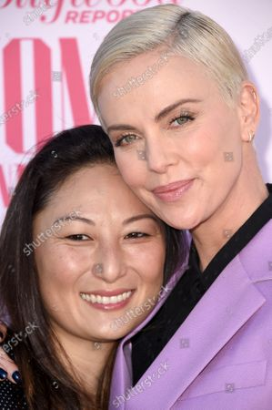 Beth Kono and Charlize Theron