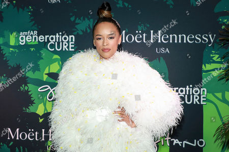 Serayah attends the amfAR GenerationCURE's 5th annual holiday party benefit at Gitano Jungle Room, in New York