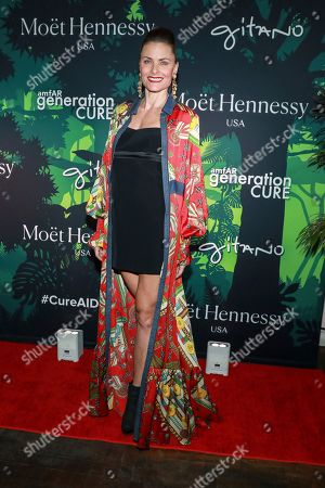 Tara Westwood attends the amfAR GenerationCURE's 5th annual holiday party benefit at Gitano Jungle Room, in New York