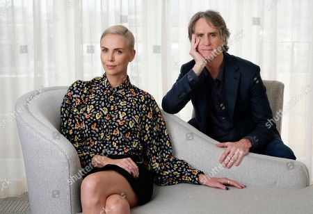 """Stock Image of Charlize Theron, Jay Roach. Charlize Theron, left, who plays former Fox News anchor Megyn Kelly in """"Bombshell,"""" poses for a portrait with the film's director Jay Roach at the Four Seasons Hotel, in Beverly Hills, Calif."""