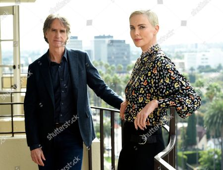 """Stock Photo of Charlize Theron, Jay Roach. Charlize Theron, right, who plays former Fox News anchor Megyn Kelly in """"Bombshell,"""" poses for a portrait with the film's director Jay Roach at the Four Seasons Hotel, in Beverly Hills, Calif. """"Bombshell"""" opens in limited release on Dec. 13 and expands wide on Dec. 20"""