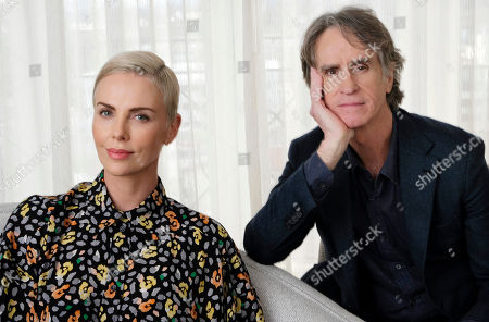 """Stock Picture of Charlize Theron, Jay Roach. Charlize Theron, left, who plays former Fox News anchor Megyn Kelly in """"Bombshell,"""" poses for a portrait with the film's director Jay Roach at the Four Seasons Hotel, in Beverly Hills, Calif."""