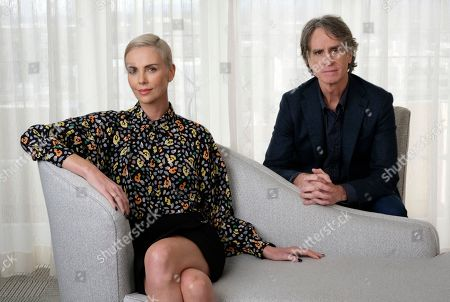 """Charlize Theron, Jay Roach. Charlize Theron, who plays former Fox News anchor Megyn Kelly in """"Bombshell,"""" poses for a portrait with the film's director Jay Roach at the Four Seasons Hotel, in Beverly Hills, Calif."""