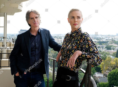 """Charlize Theron, Jay Roach. Charlize Theron, right, who plays former Fox News anchor Megyn Kelly in """"Bombshell,"""" poses for a portrait with the film's director Jay Roach at the Four Seasons Hotel, in Beverly Hills, Calif. """"Bombshell"""" opens in limited release on Dec. 13 and expands wide on Dec. 20"""