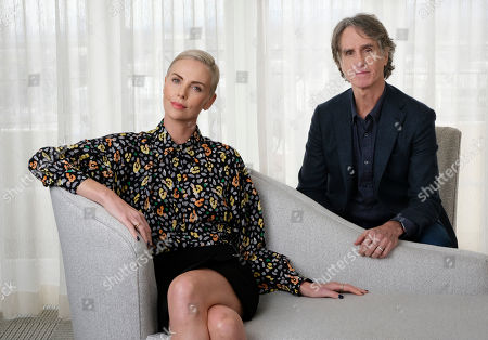 """Charlize Theron, Jay Roach. Charlize Theron, left, who plays former Fox News anchor Megyn Kelly in """"Bombshell,"""" poses for a portrait with the film's director Jay Roach at the Four Seasons Hotel, in Beverly Hills, Calif.""""Bombshell"""" opens in limited release on Dec. 13 and expands wide on Dec. 20"""