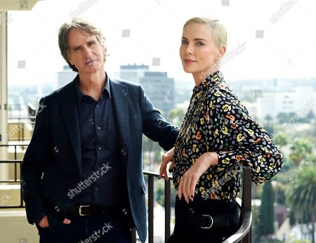 """Charlize Theron, Jay Roach. Charlize Theron, right, who plays former Fox News anchor Megyn Kelly in """"Bombshell,"""" poses for a portrait with the film's director Jay Roach at the Four Seasons Hotel, in Beverly Hills, Calif."""