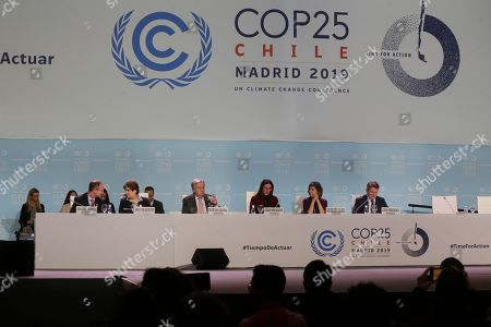 Antonio Guterres, Secretary-General of the United Nations, 3rd left, takes a drink of water before delivering a speech during a Global Climate Plenary event at the COP25 climate talks congress in Madrid, Spain