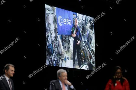 Antonio Guterres, Secretary-General of the United Nations, centre and Spain's Science and Innovation Minister Pedro Duque, left, speak via a video link-up with Italian astronaut Luca Parmitano from the International space station during a Global Climate Plenary Event at the COP25 climate talks congress in Madrid, Spain