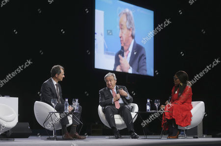 Antonio Guterres, Secretary-General of the United Nations, centre, speaks with Spain's Science and Innovation Minister Pedro Duque during a Global Climate Plenary Event at the COP25 climate talks congress in Madrid, Spain