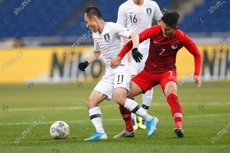 Moon Seon-min (L) of South Korea in action against Wong Wai (R) of Hong Kong during the EAFF E-1 Football Championship men's match between South Korea and Hong Kong at the Busan Asiad Main Stadium in Busan, South Korea, 11 December 2019.
