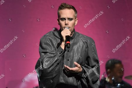 "Justin Tranter performs during the 9th annual ""Home for the Holidays"" benefit concert at The Novo, in Los Angeles"