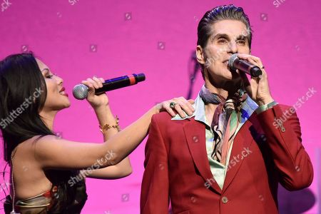 "Etty Lau Farrell, Perry Farrell. Etty Lau Farrell, left, and Perry Farrell perform during the 9th annual ""Home for the Holidays"" benefit concert at The Novo, in Los Angeles"