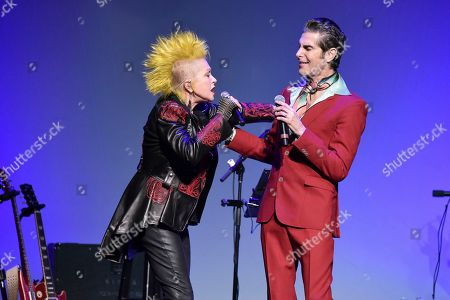 "Cyndi Lauper, Perry Farrell. Cyndi Lauper, left, and Perry Farrell perform during the 9th annual ""Home for the Holidays"" benefit concert at The Novo, in Los Angeles"