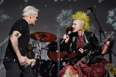 """Cyndi Lauper, Henry Rollins. Cyndi Lauper, left, and Henry Rollins perform during the 9th annual """"Home for the Holidays"""" benefit concert at The Novo, in Los Angeles"""