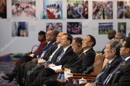Officials including Chinese Vice Foreign Minister Ma Zhaoxu, fifth from right attend a forum on human rights in Beijing on . Chinese officials lashed out at the U.S. on Wednesday over recent legislation passed by Congress criticizing Beijing for its policies in Hong Kong and the Xinjiang region in western China, as well as ongoing trade disputes