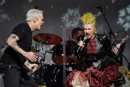"""Stock Photo of Cyndi Lauper, Henry Rollins. Cyndi Lauper, left, and Henry Rollins perform during the 9th annual """"Home for the Holidays"""" benefit concert at The Novo, in Los Angeles"""